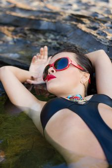 Woman Relaxing In Water Royalty Free Stock Images