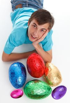 Free Boy With A Bunch Of Chocolate Easter Eggs Royalty Free Stock Image - 19128296