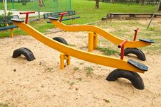 Free Yellow Seesaw Royalty Free Stock Photo - 19133015