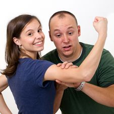 Free Husband  S Shock At Wife S Muscles Royalty Free Stock Image - 19133326