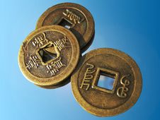 Free Three Ancient Chinese Coins On A Mirror Royalty Free Stock Photography - 19133817