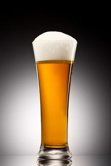 Free Beer Into Glass On A Gray Stock Photography - 19134562