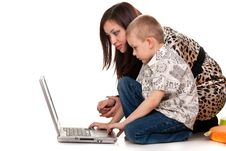 Mother And Son Playing With Laptop Royalty Free Stock Images