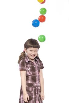 Young Girl With Balls Royalty Free Stock Images