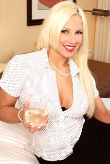 Free Sexy Blond Smiling With Wine Glass Stock Photography - 19144602