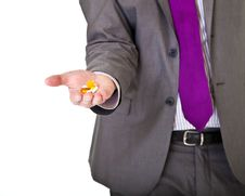 Free Man In Suit Holding Pills Isolated Stock Photos - 19144693