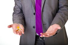 Free Man In Suit Holding Pills Isolated Royalty Free Stock Image - 19144746