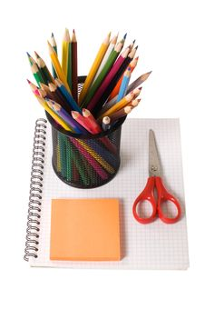 Set Of Pencils On A Writing-book Stock Photo