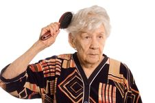 Free The Elderly Woman Brushes Hair Royalty Free Stock Photos - 19148178