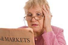 Free Elderly Woman Reads The Newspaper Stock Photography - 19148222