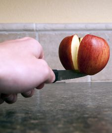 Free Apple Being Cut In Half Stock Images - 19158164