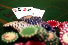 Four Aces And A Pile Of Chips Stock Photo