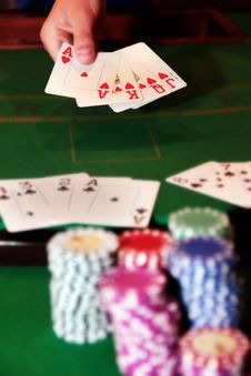 Free Poker Player Showing Unbeatable Royal Flush Royalty Free Stock Image - 19162096