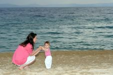 Free Mother With Her Baby At Beach Royalty Free Stock Photography - 19162487