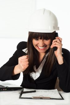 Girl Sitting In The Construction Helmet Stock Image