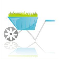 Garden Wheelbarrow With Grass Royalty Free Stock Photos