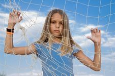 Girl Behind The Rope Net Royalty Free Stock Photos