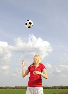 Young Woman Playing With Soccer Ball Royalty Free Stock Photos
