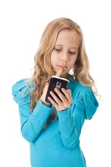 Free Girl Playing Games In Her Phone Royalty Free Stock Photos - 19169488