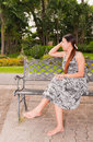 Free Asian Women Distracted On Bench Faced Right Royalty Free Stock Photography - 19171117