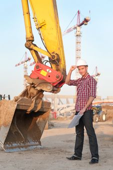 Architect Working Outdoors On A Construction Site Royalty Free Stock Images