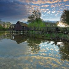 Clouds Reflection In Water With Watermill Royalty Free Stock Image