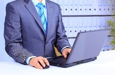 Male Hand On Mouse While Working On Laptop Royalty Free Stock Photo