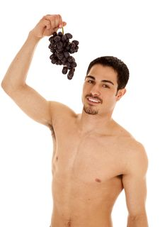 Man Holding Up Grapes Stock Photography