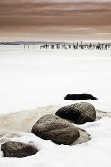 Free Pier And Stones In Frozen Sea Royalty Free Stock Image - 19177976