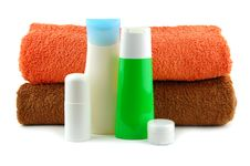 Free Cosmetic Bottles With Bath Towels Stock Images - 19179474