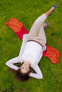 Free Brunette Lying In The Grass Royalty Free Stock Photos - 19184208
