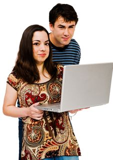 Free Couple Using A Laptop Royalty Free Stock Image - 19182376