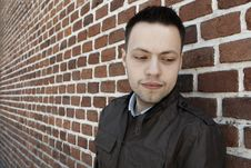 Free Young Man In Fron Of The Brick Wall Royalty Free Stock Photography - 19189777
