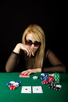 Sexy Blond Playing Poker Royalty Free Stock Image