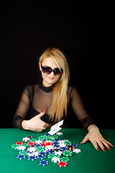 Sexy Blond Playing Poker Royalty Free Stock Photos
