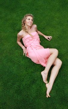 Young Attractive Blond Girl On The Green Grass Royalty Free Stock Images
