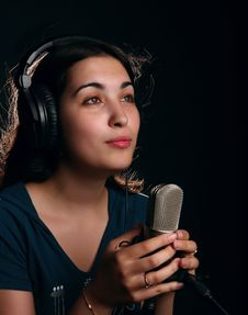 Free Girl With A Microphone And Head-phones Royalty Free Stock Photos - 19192498