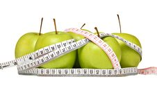 Fresh Green Apples With Measuring Tape Royalty Free Stock Photo