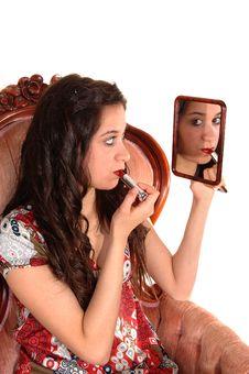 Free Girl Putting Lipstick On. Royalty Free Stock Image - 19198316