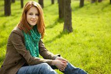 Beautiful Girl Sitting At Green Grass At Park. Royalty Free Stock Image