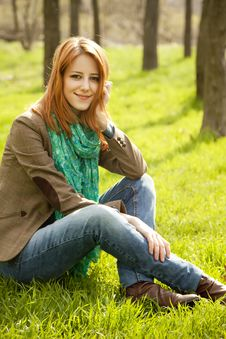Free Beautiful Girl Sitting At Green Grass At Park. Royalty Free Stock Image - 19199646