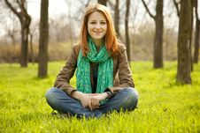 Free Beautiful Girl Sitting At Green Grass At Park. Royalty Free Stock Images - 19199659