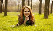 Free Beautiful Girl Sitting At Green Grass At Park. Stock Images - 19199664