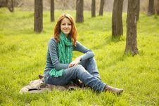 Free Beautiful Girl Sitting At Green Grass At Park. Royalty Free Stock Photos - 19199688