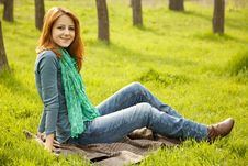 Free Beautiful Girl Sitting At Green Grass At Park. Stock Photography - 19199702