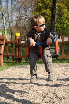 Free Boy With Sunglasses On Swing Stock Image - 19199891