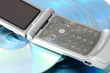 Cd S And A Cell Phone Stock Images
