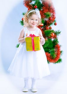 Free Cute Girl Wearing Snowflake Costume With Gift Royalty Free Stock Photos - 19202428