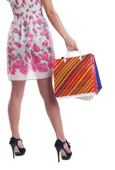 Tall Woman Legs With Stiped Shopping Bags Royalty Free Stock Image