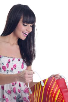 Young Girl Look In Bag And Smile Royalty Free Stock Images